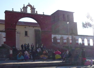 The Church at the village near Chucuito.  The cross out front is the marker of the Inquisition. The dancers are on day four of a wedding celebration