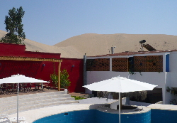 Pool at Villa Jazmin at Nazca with Dune in background