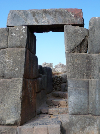 A doorway from one level to the next of the zigzag surround of the main temple site at Saqsaywaman